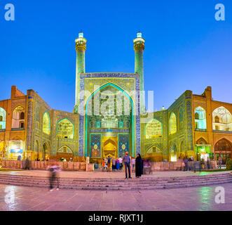 ISFAHAN, IRAN - OCTOBER 19, 2017: The main entrance portal to Shah Mosque with double minarets on its sides, on October 19 in Isfahan - Stock Photo