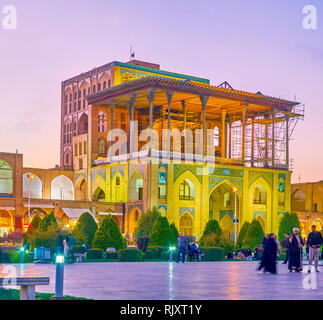 ISFAHAN, IRAN - OCTOBER 19, 2017: The magnificent Ali Qapu Palace with covered gallery with a view on Nashq-e Jahad Square, on October 19 in Isfahan - Stock Photo