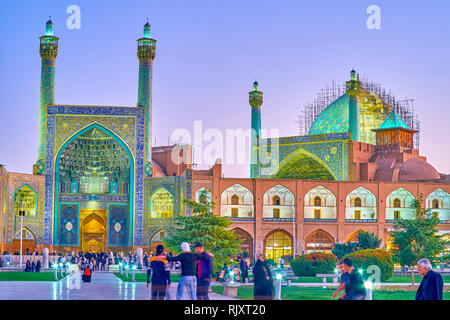ISFAHAN, IRAN - OCTOBER 19, 2017: The beautiful evening illumination of colorful Shah Mosque, on October 19 in Isfahan - Stock Photo