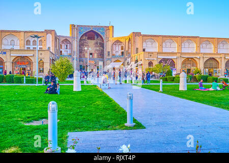 ISFAHAN, IRAN - OCTOBER 19, 2017: The old Qeysarie Gates with partly preserved decorations located in Naqsh-e Jahan Square, on October 19 in Isfahan - Stock Photo