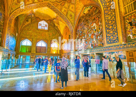 ISFAHAN, IRAN - OCTOBER 19, 2017: Tourists walk in the main hall enjoying amazing decorations of Chehel Sotoun Palace, on October 19 in Isfahan - Stock Photo