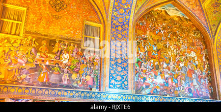 ISFAHAN, IRAN - OCTOBER 19, 2017: The full wall frescoes in main hall of Chehel Sotoun Palace are the fine examples of Persian style decorations, on O - Stock Photo