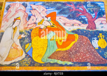 ISFAHAN, IRAN - OCTOBER 19, 2017: The colorful frescoe in main hall of  Chehel Sotoun Palace depicts the scenes from the old Persian stories, on Octob - Stock Photo