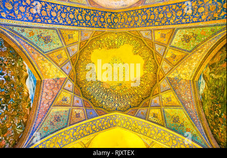 ISFAHAN, IRAN - OCTOBER 19, 2017: The richly decorated ceilings and walls of the main hall of Chehel Sotoun Palace, on October 19 in Isfahan - Stock Photo