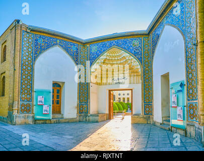 ISFAHAN, IRAN - OCTOBER 19, 2017: The colorful decorated main portal of Masoudieh mansion, on October 19 in Isfahan - Stock Photo