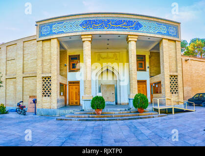 ISFAHAN, IRAN - OCTOBER 19, 2017: The beautiful portal of Museum Of Decorative Arts with persian styled ornament, on October 19 in Isfahan - Stock Photo