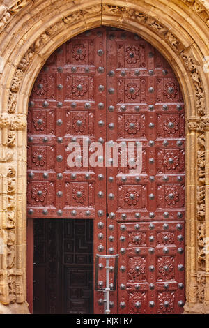 Antique wooden door and stone arch in gothic style. Spain - Stock Photo