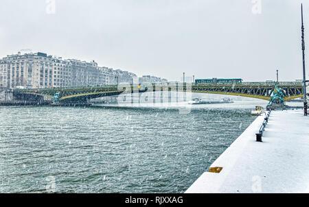 Snowfall on Pont Mirabeau over the Seine - Paris - Stock Photo