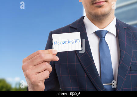 Man presenting marketing one-hundred and one by holding card in hand as must-know information concept - Stock Photo