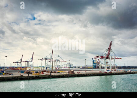 Cranes on commercial dock - Stock Photo