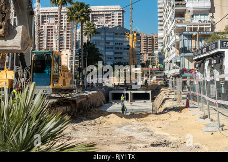 Local council and engineers in La Cala, Alicante province, Spain instal culverts to channel flood waters under the streets during flash floods - Stock Photo