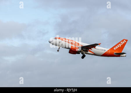 AMSTERDAM / NETHERLANDS - JAN 08, 2019: easyJet Airbus A319-111 G-EZFZ passenger plane taking off from Amsterdam Schiphol Airport - Stock Photo
