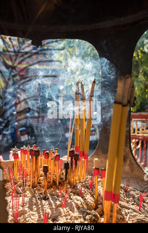 Incense burning in chinese temple. Pung Thao Kong Shrine chinese temple in Chiang Mai, Thailand - Stock Photo
