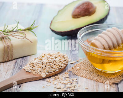 skin care natural products ingredients for scrub body mask: honey, avocado, oat flakes - Stock Photo