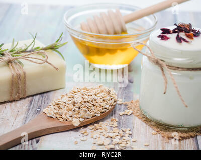 skin care natural products ingredients for scrub body mask: honey, white yogurt, oat flakes - Stock Photo