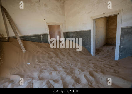 Sand has invaded and taken over these rooms in Kolmanskoppe, Namibia - Stock Photo
