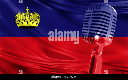 Microphone on fabric background of flag of Liechtenstein close-up - Stock Photo