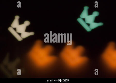 Blurred photo of defocused bokeh colorful lights in the shape of crown. - Stock Photo
