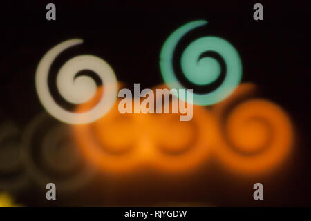 Blurred photo of defocused bokeh colorful lights in the shape of spiral. - Stock Photo