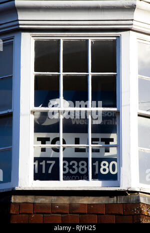 To let sign for vacant shop unit in city centre - Stock Photo