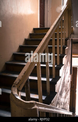 staircase leading down in a tenement house in Warsaw - Stock Photo