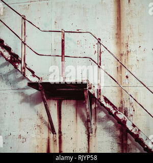 Old and rusty metal steps going up the side of a green tower at an abandoned coal depot, Edinburgh, Scotland - Stock Photo