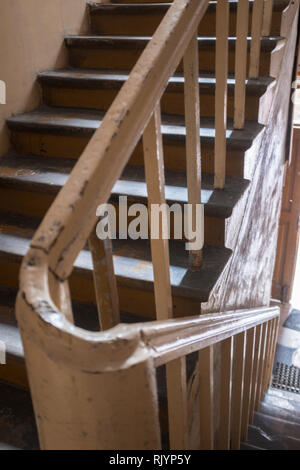 curve of a bannister on a staircase in a tenement house in Warsaw - Stock Photo
