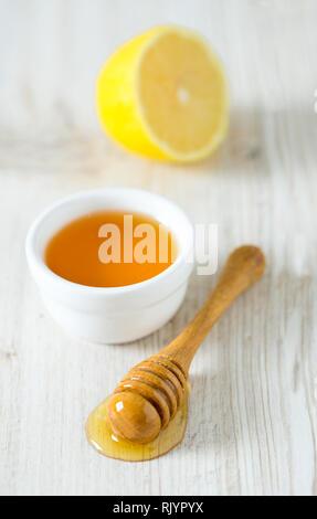 honey on wooden surface - Stock Photo