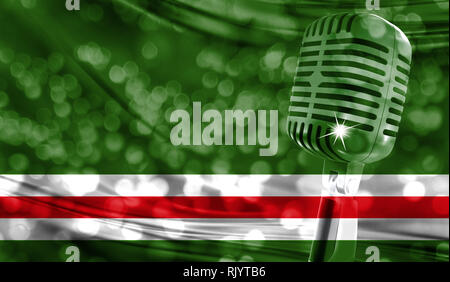 Microphone on a background of a blurry Chechen Republic of Ichkeria flag close-up - Stock Photo