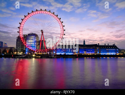 A twenty-second exposure, of the English London Eye and County Hall, taken to smooth out the River Thames. It was taken from near Westminster bridge. - Stock Photo