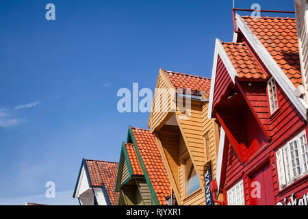 STAVANGER, NORWAY - AUGUST 14, 2018: Colorful facade of old wooden warehouse at Skagenkaien, a popular tourist attraction in Old Stavanger - Stock Photo