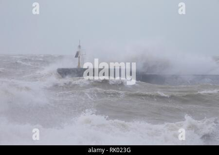 Hastings, East Sussex, UK. 08 Feb, 2019. UK Weather: Storm Erik. Gale force winds bring raging seas to Hastings in East Sussex. The harbour arm takes a battering from the waves. © Paul Lawrenson 2019, Photo Credit: Paul Lawrenson / Alamy Live News - Stock Photo