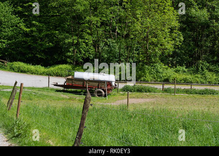 Old abandoned rusty car trailer tank as cattle-drinking