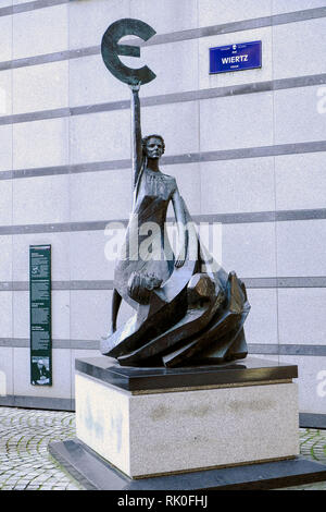 Brussels, Belgium - dramatic sculpture with European symbol E in front of the building Paul-Henri Spaak of the European Parliament in Brussels, which - Stock Photo
