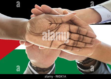 Sahrawi Arab Democratic Republic flag, intergration of a multicultural group of young people - Stock Photo