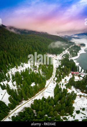 Amazing winter Landscape of Dospat Reservoir, Smolyan Region, Bulgaria - Drone winter top shot - Stock Photo