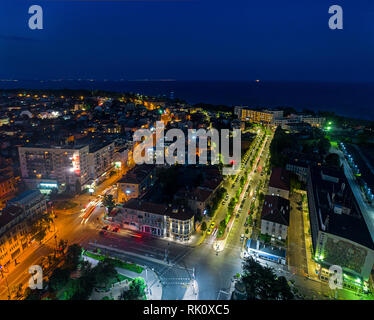 The light on the road roundabout at night and the city in Burgas, Bulgaria. Road beautiful Aerial View of Busy Intersection, Aerial view. - Stock Photo
