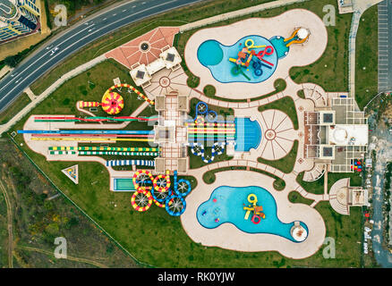 Aerial drone view looking straight down from above colorful autumn time fun at water park. Top view.Sunset Aquapark Pomorie - Stock Photo
