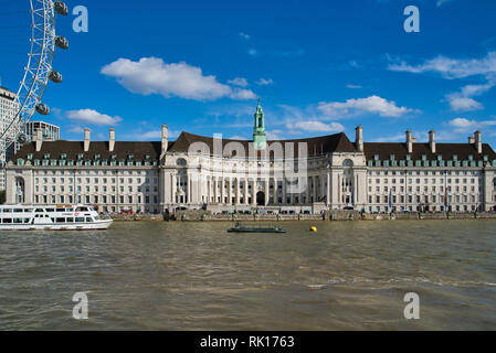 LONDON, UK - SEPTEMBER 9, 2018: London Aquarium in the County Hall and the London Eye - Stock Photo