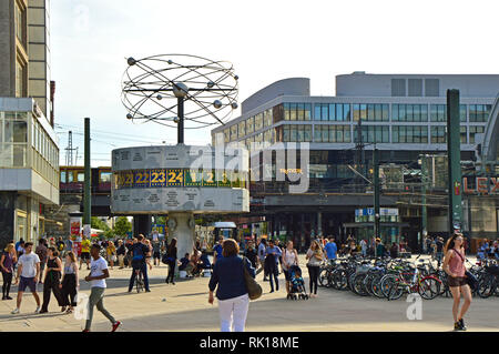 BERLIN, GERMANY - JUNE 21, 2017: people in Berlin's Alexanderplatz square with the Weltzeituhr (World Time Clock). Alexanderplatz is also an important - Stock Photo