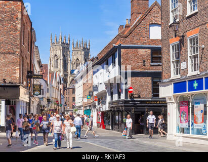 York Minster and shops on Low Petergate and Kings square crossroads York Yorkshire England gb uk Europe - Stock Photo