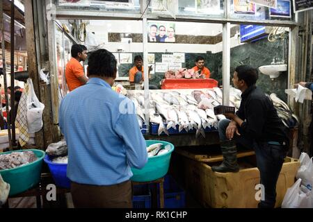 INA Market center shops in the capital of Delhi where shop merchants are selling fresh meat, mutton, and fish. - Stock Photo