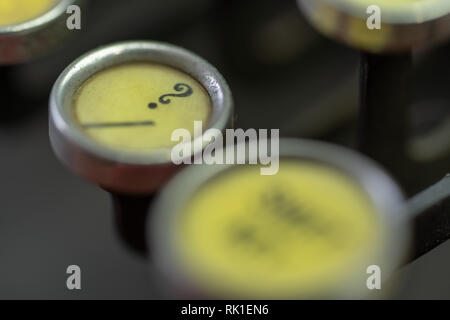 A closeup of the question mark key of an antique typewriter. - Stock Photo