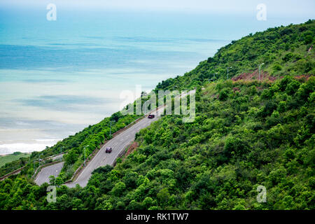 multilayer road going on a mountain looking awesome with a beach background. - Stock Photo