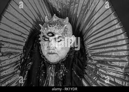 Man with third eye, thorns or warts. Senior man with white beard dressed like monster. Alien, demon, sorcerer makeup. Horror and fantasy concept - Stock Photo