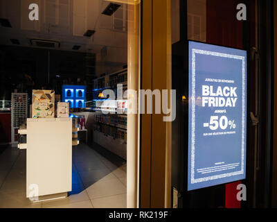 STRASBOURG, FRANCE - CIRCA 2019: Digital display at night Black Friday minus 50 percent sign on the showcase glass of a store in central shopping street during Black Friday sales - Stock Photo