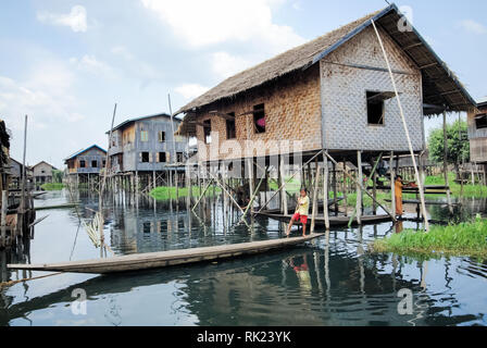 Inle Lake, Myanmar - June 23, 2015: Wooden houses on the water on stilts, a fishing village on Inle Lake in Myanmar. - Stock Photo