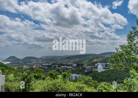 Awesome view of city building from top of a mountain with white sky cloud. - Stock Photo