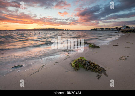 Sunset over Poole Harbour and Brownsea Island - Stock Photo