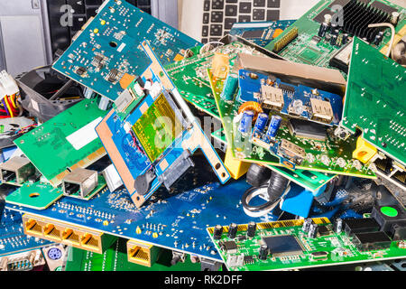 E-waste heap from old discarded laptop and PC parts. Industrial background from electronic components. Mainboards, PCB, cards and keyboards. Ecology. - Stock Photo